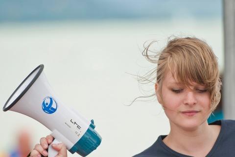 Woman holding loudhailer