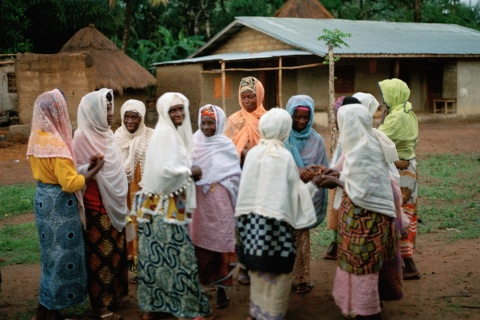 Women gather outside the mosque in Masethele, Bombali District, Sierra Leone.