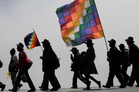 Protesters carry flags representing their indigenous movement in Bolivia. Photograph: Dolores Ochoa/AP