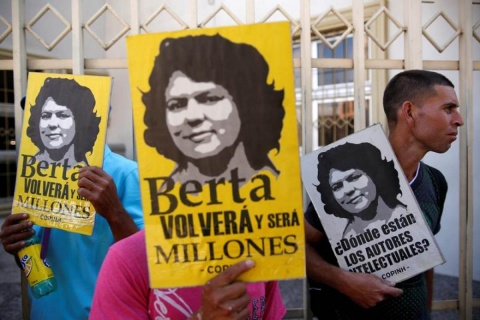 """Indigenous people protest outside a court during a hearing of Roberto David Castillo, arrested on charges of helping plan the murder of Berta Caceres, in Tegucigalpa, Honduras March 3, 2018. Placard reads: """"Berta will come back again and she will be milli"""