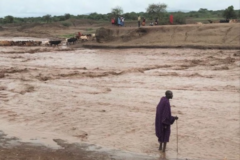 Maasai herder on the flooded Mundarara road, northern Tanzania