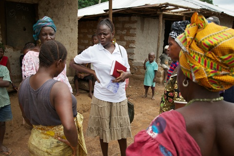 A paralegal speaks with community members in Mamusa community, Sierra Leone.