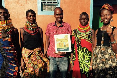 The women elected as Community Land Mobilizers in Turkana, Kenya standing with Kenya Land Alliance facilitator (center) and the Namati facilitators.