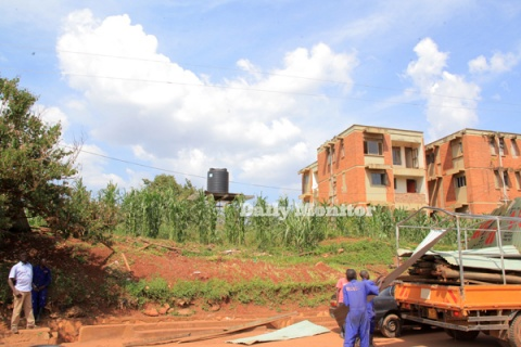 People load iron sheets and poles onto a truck after houses were destroyed at the Naguru-Nakawa housing estate land in December 2020. PHOTO/ RACHEL MABALA