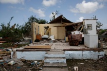 Barbuda one month after Hurricane IrmaX. A home is seen in ruins in Codrington on the island of Barbuda